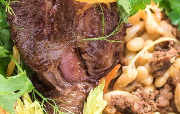 Braised Lamb Shanks with Merguez Sausage and White Beans